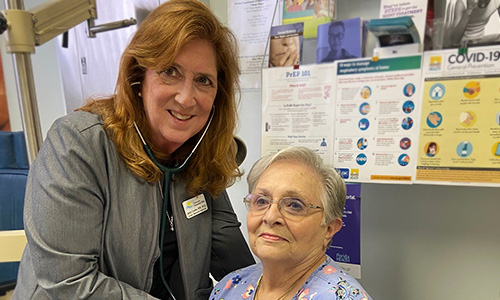 Janice Chupka, VBA Dir. of Clinic Services, picture with patient